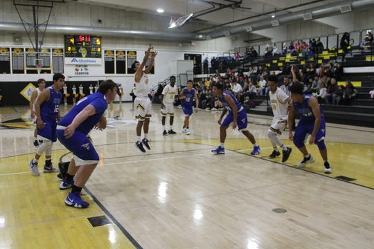 The Tigers' Diego Ortega takes a shot from the foul line in a particularly foul-heavy game against Lovington.