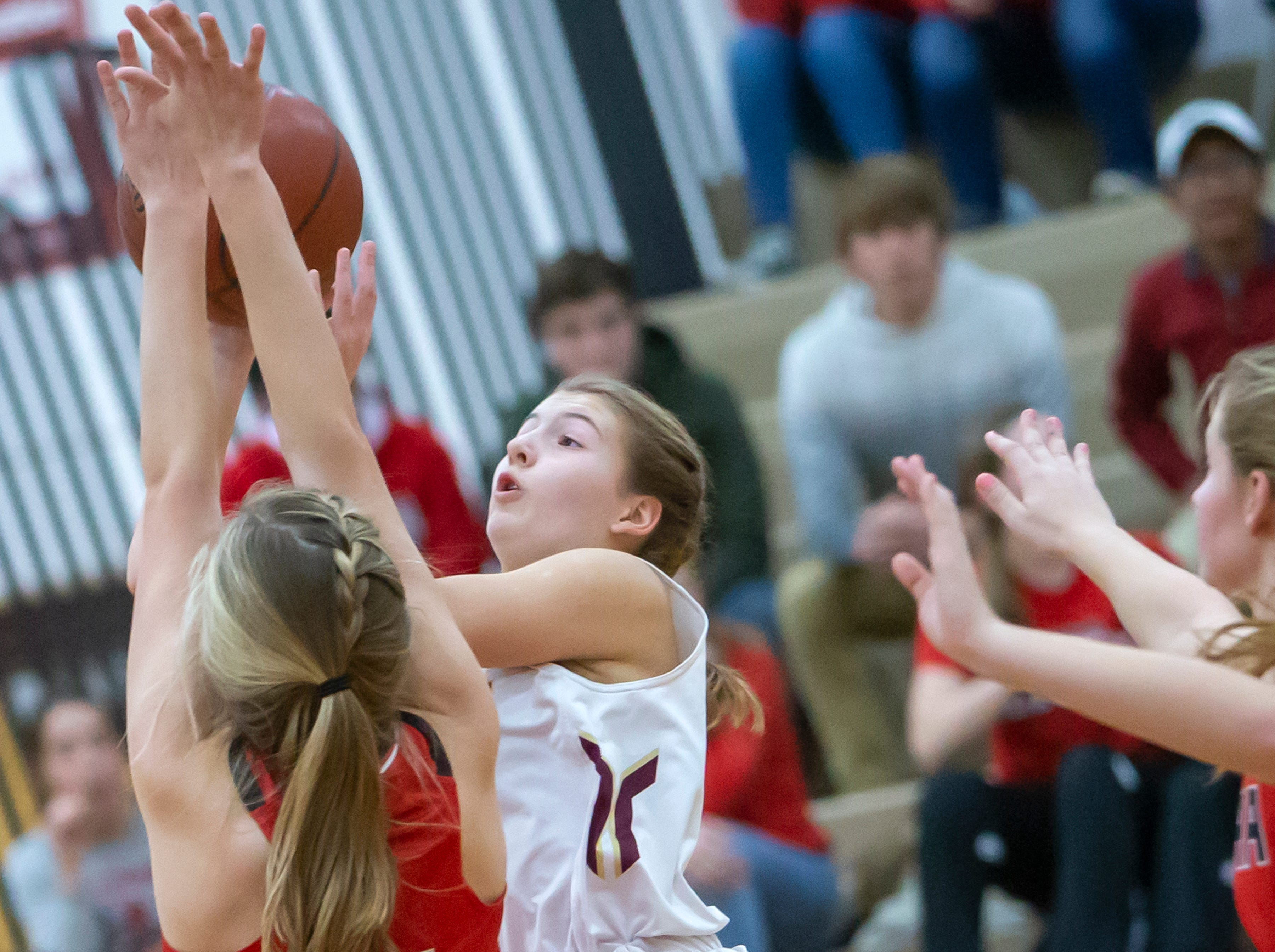 Omro's Hannah Fedderly shoots over Lomira's Autumn Schrauth at Omro High School on Friday, December 14, 2018.