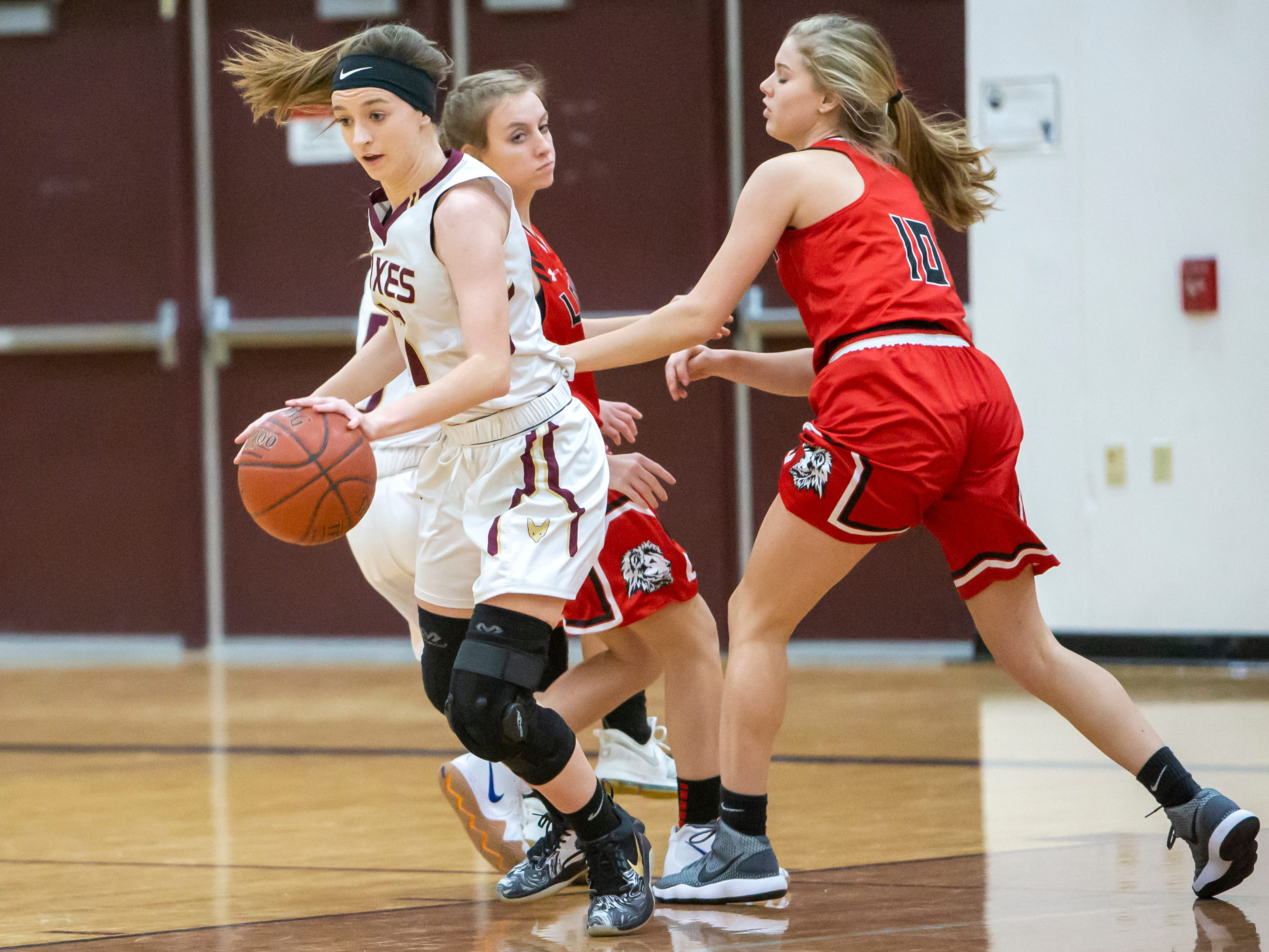 Omro's Danycka Milis takes the ball across the court at Omro High School playing against Lomira on Friday, December 14, 2018.