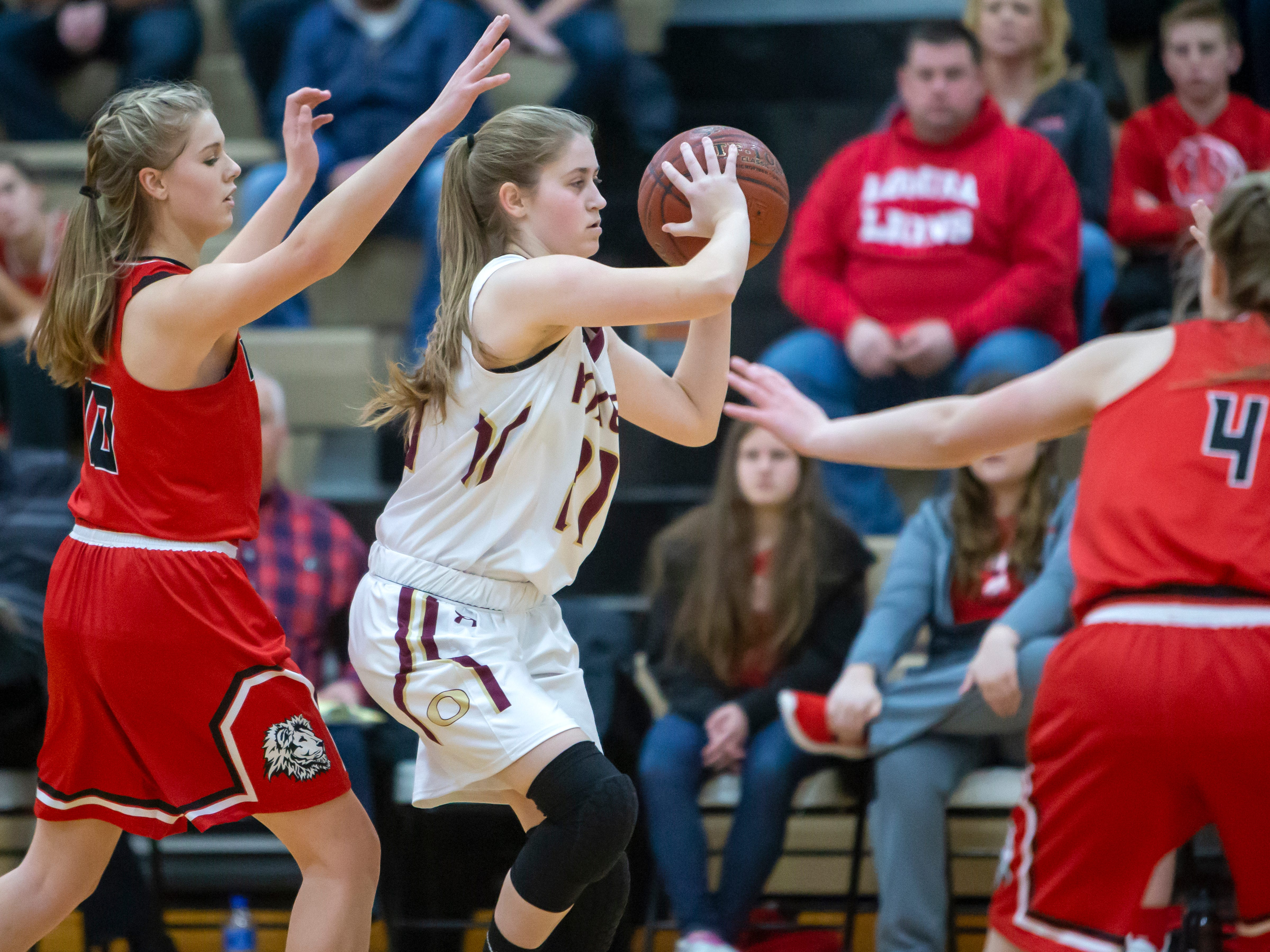Omro's Tabitha Kilgas throws a pass during the game against Lomira at Omro High School on Friday, December 14, 2018.