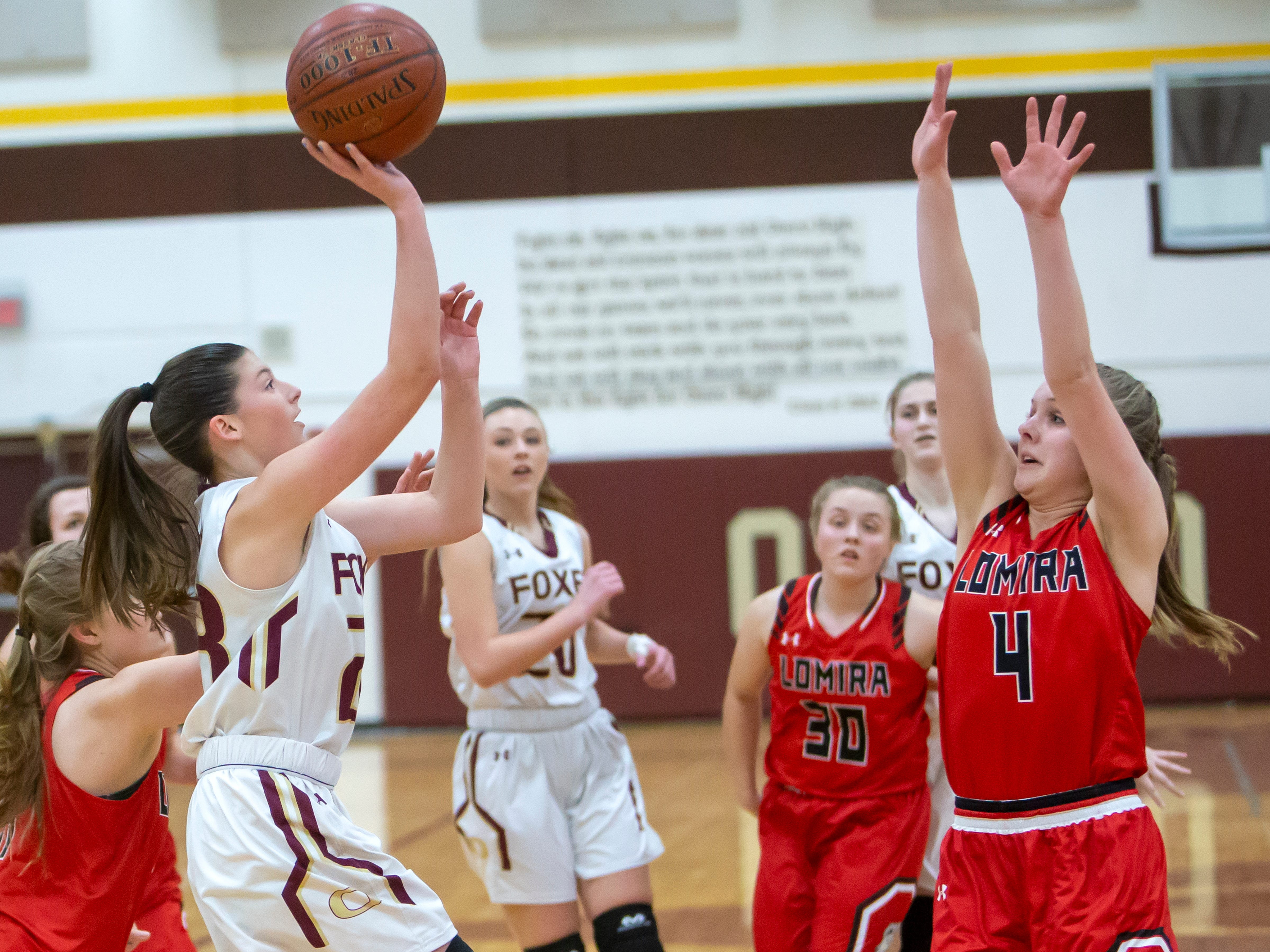 Omro's Bobbi Allison puts up a shot over Lomira's Lizzy Wulff at Omro High School on Friday, December 14, 2018.