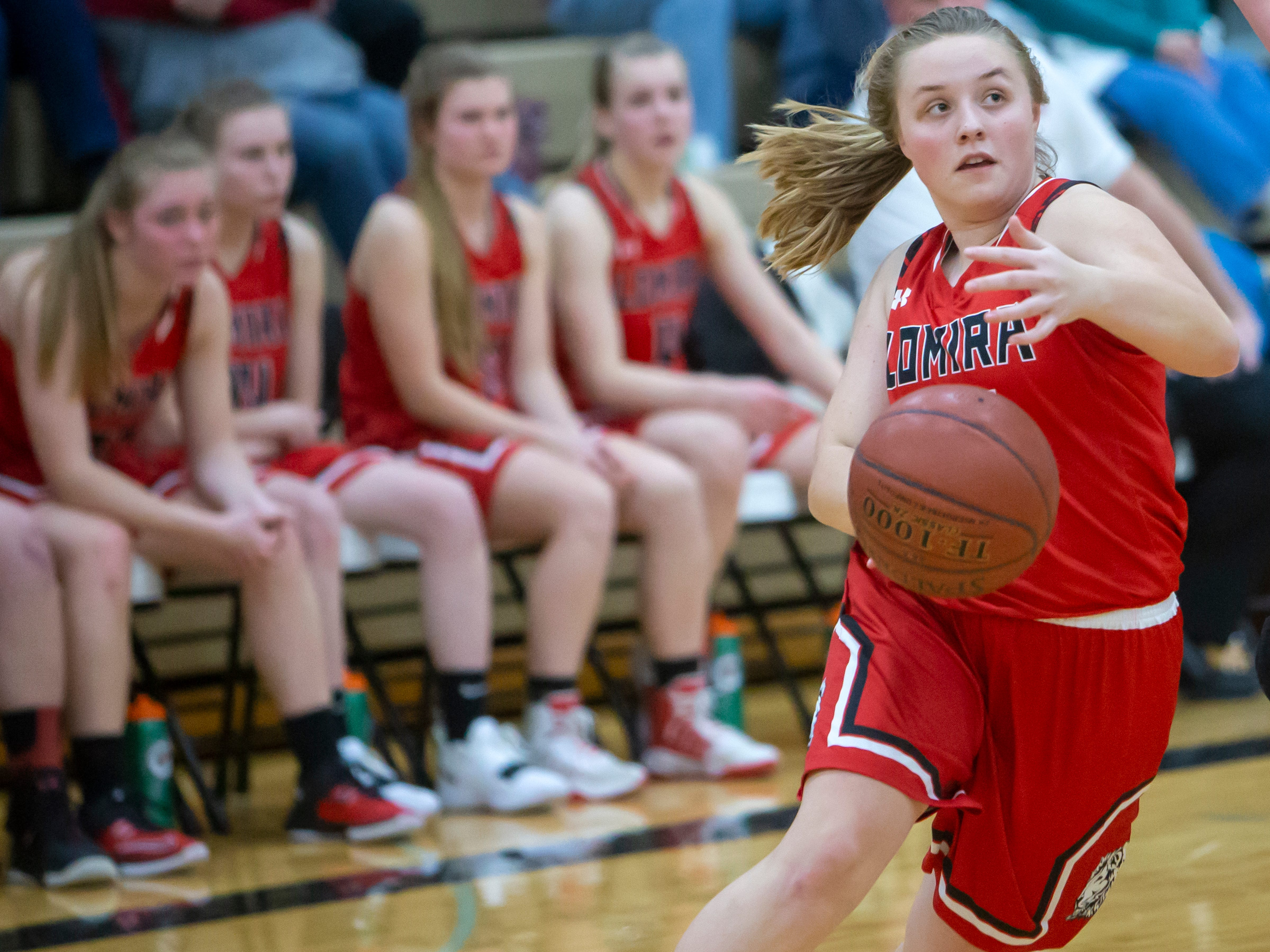Lomira's Erin Ries drives the ball to the basket at Omro High School playing against the Foxes on Friday, December 14, 2018.