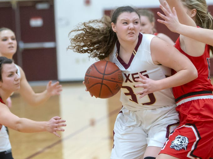 Omro's Autumn Davis drives the ball to the basket around Lomira blockers at Omro High School on Friday, December 14, 2018.