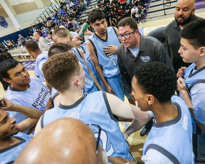 Rancho Mirage coach Rob Hanmer gathers his team for strategy during a timeout on Friday, Dec. 14. Rancho Mirage beat Shadow Hills 88-75 in boys' basketball.