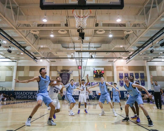 Members of the Shadow Hills and Rancho Mirage boys' basketball teams await a free throw attempt on Friday, Dec. 14. Rancho Mirage beat Shadow Hills 88-75 in boys' basketball.