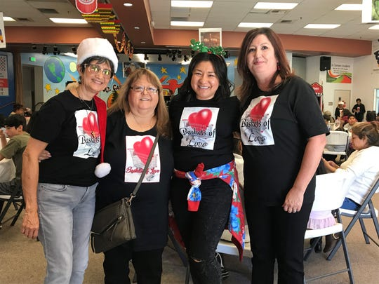 Rena Agoot, second from left, created what has becomes Baskets of Love more than 20 years ago. She's joined by volunteers Regina Heredia, Karena Heredia and Lorraine Cornejo.