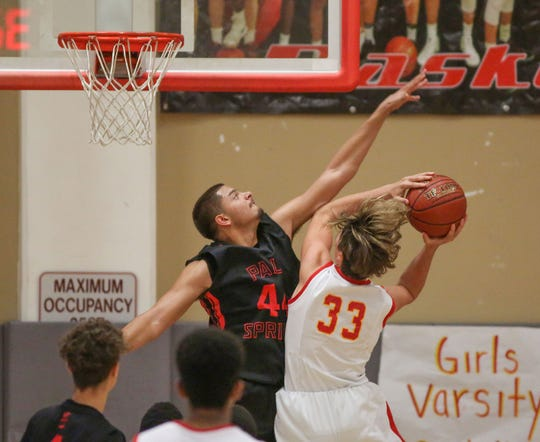 Palm Springs' Parker hunt goes for the blocked shot against Palm Desert earlier this season. Hunt was named the league's MVP.