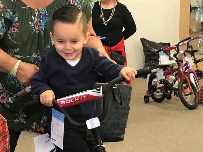Troy Aviña, 3, received a bicycle on Saturday, Dec. 15, at the annual Baskets of Love event in Indio.