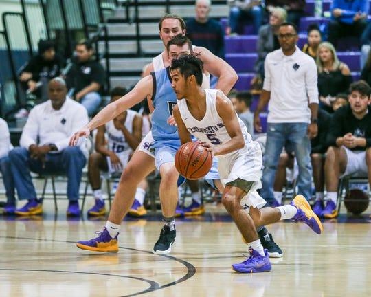 Jake Abawag of Shadow Hills drives past a Rancho Mirage defender on Friday, Dec. 14. Rancho Mirage beat Shadow Hills 88-75 in boys' basketball.