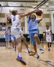 Joseph Rojas, right, of Rancho Mirage goes up for a shot against Cord Stansberry of Shadow Hills on Friday, Dec. 14. Rancho Mirage beat Shadow Hills 88-75 in boys' basketball.