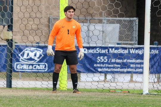 Pensacola Catholic goalkeeper Mack Hamrick (1) watches as the play develops near the Crusaders' sideline against Clinton at Gulf Breeze High School on Saturday, December 15, 2018.