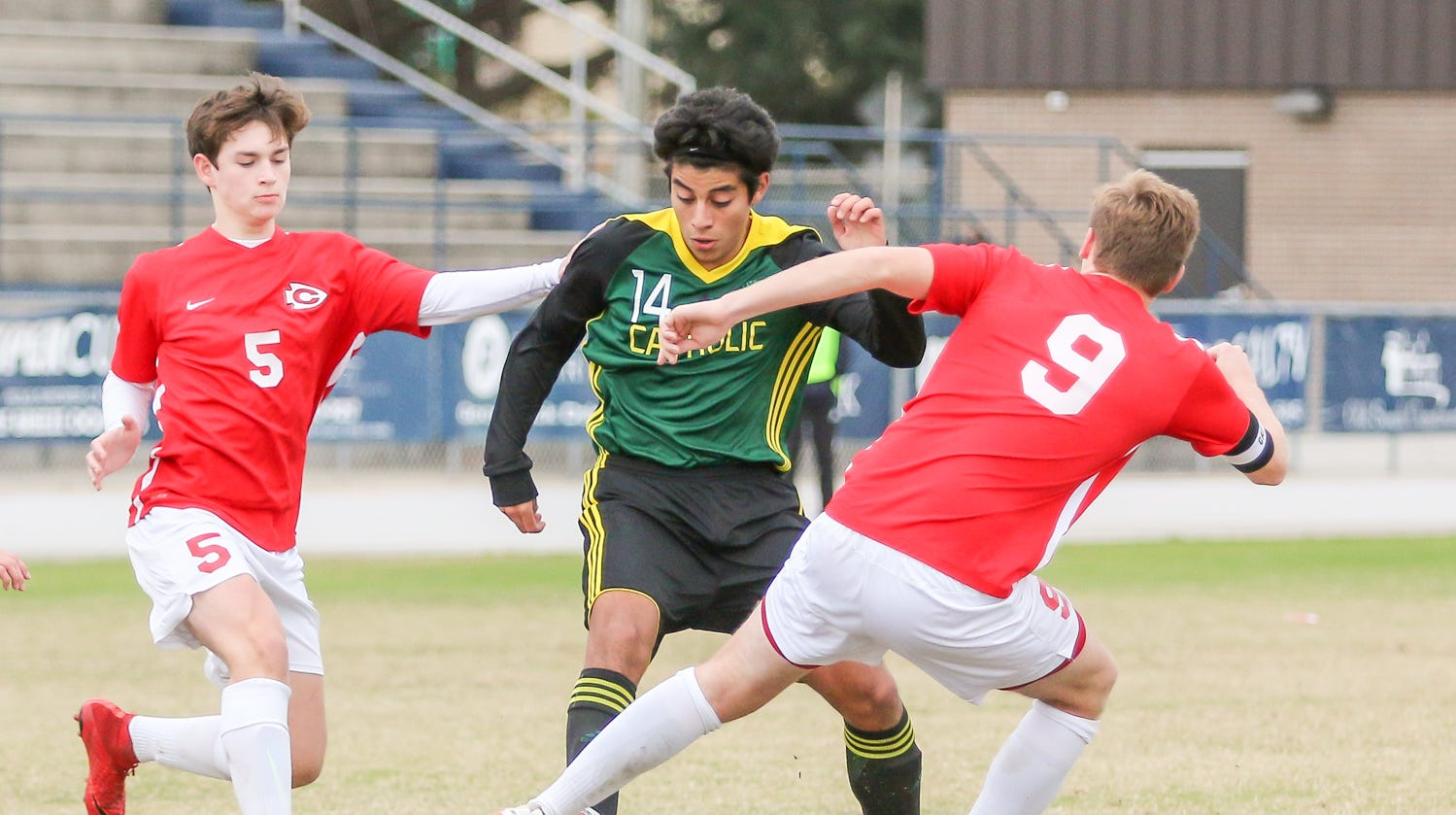 Pensacola Catholic's Mario Cardenas (14) steals the ball from Clinton's Nathan Thomas (9) at Gulf Breeze High School on Saturday, December 15, 2018.