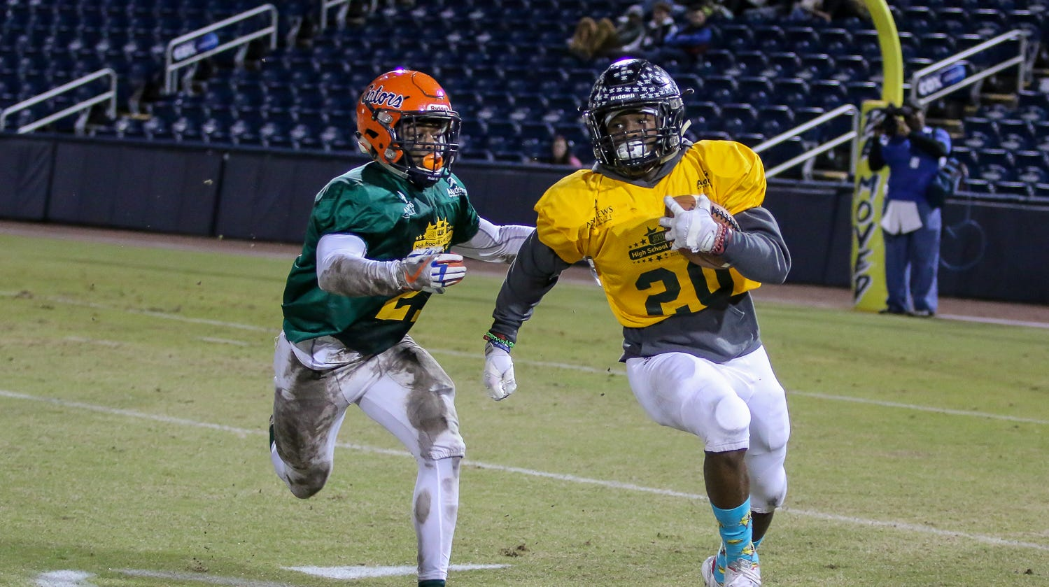 Escambia's Patrick Sanders (21) chases after Navarre's Chris Williams (20) in Pensacola Sports' annual Subway High School All-Star Game at Blue Wahoos Stadium on Friday, December 14, 2018. Players from Escambia County schools made up the West team and players from schools in Santa Rosa & Okaloosa counties made up the East team.