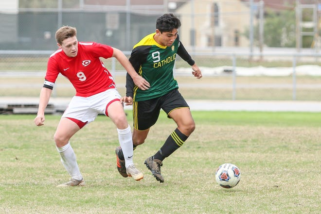 Pensacola Catholic's Nelson Libbert, right, moves the ball away from Clinton's Nathan Thomas at Gulf Breeze High School on Saturday, December 15, 2018.