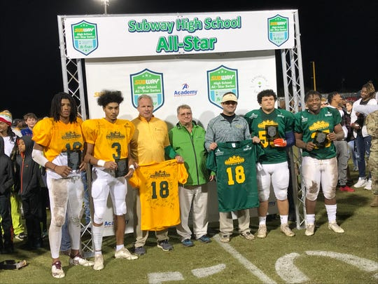 The East and West game MVPs along with both squads head coaches together after Friday night's 15th annual Subway High School All Star Football game produced by Pensacola Sports.