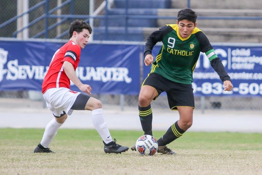 Pensacola Catholic's Nelson Libbert (9) keeps the ball away from the Clinton defender at Gulf Breeze High School on Saturday, December 15, 2018.
