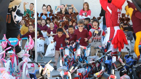 Kindergartners at Garfield Elementary received new bikes.