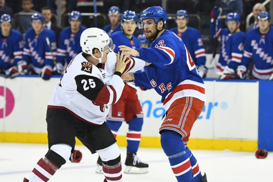 Dec 14, 2018; New York, NY, USA; New York Rangers defenseman Brendan Smith (42) and Arizona Coyotes center Nick Cousins (25) fight in the first period at Madison Square Garden. Mandatory Credit: Catalina Fragoso-USA TODAY Sports
