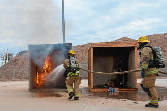 The Tempe Fire Department set Christmas trees ablaze in the name of safety at their fire training facility in Tempe, Arizona on Saturday Dec. 15, 2018.
