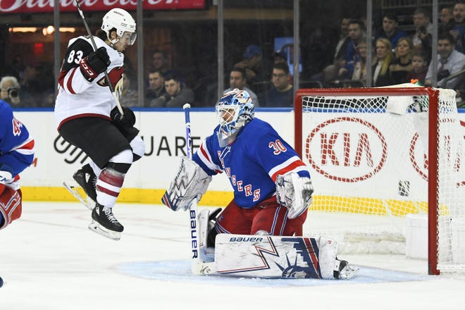 Dec 14, 2018; New York, NY, USA; New York Rangers goalie Henrik Lundqvist (30) makes a save against Arizona Coyotes right wing Conor Garland (83) in the first period at Madison Square Garden. Mandatory Credit: Catalina Fragoso-USA TODAY Sports