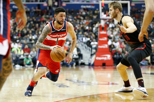 Nov 18, 2018; Washington, DC, USA; Washington Wizards guard Austin Rivers (1) dribbles the ball as Portland Trail Blazers forward Jake Layman (10) defends during the second quarter at Capital One Arena. Mandatory Credit: Amber Searls-USA TODAY Sports