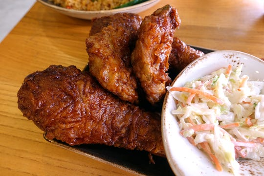 Garlic soy fried chicken leg and wings with coleslaw at Bonchon in Tempe.