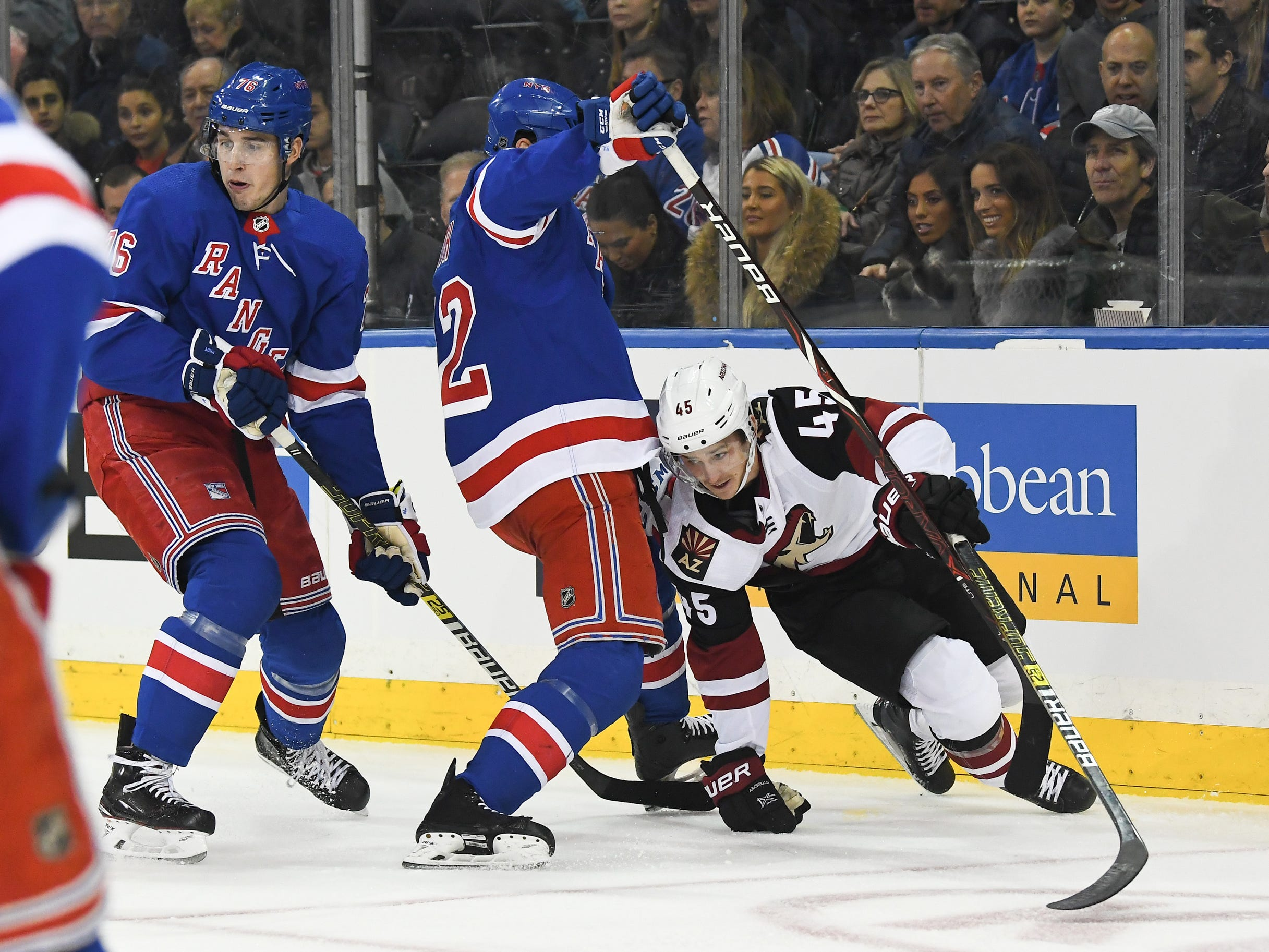 Dec 14, 2018; New York, NY, USA; New York Rangers defenseman Brendan Smith (42) collides with Arizona Coyotes right wing Josh Archibald (45) in the first period at Madison Square Garden. Mandatory Credit: Catalina Fragoso-USA TODAY Sports