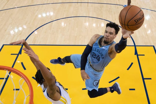 November 5, 2018; Oakland, CA, USA; Memphis Grizzlies guard Dillon Brooks (24) shoots the basketball against Golden State Warriors guard Damion Lee (1) during the second half at Oracle Arena. Mandatory Credit: Kyle Terada-USA TODAY Sports