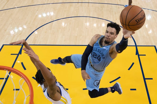 Grizzlies guard Dillon Brooks puts up a shot over Warriors guard Damion Lee during a game on Nov. 5.