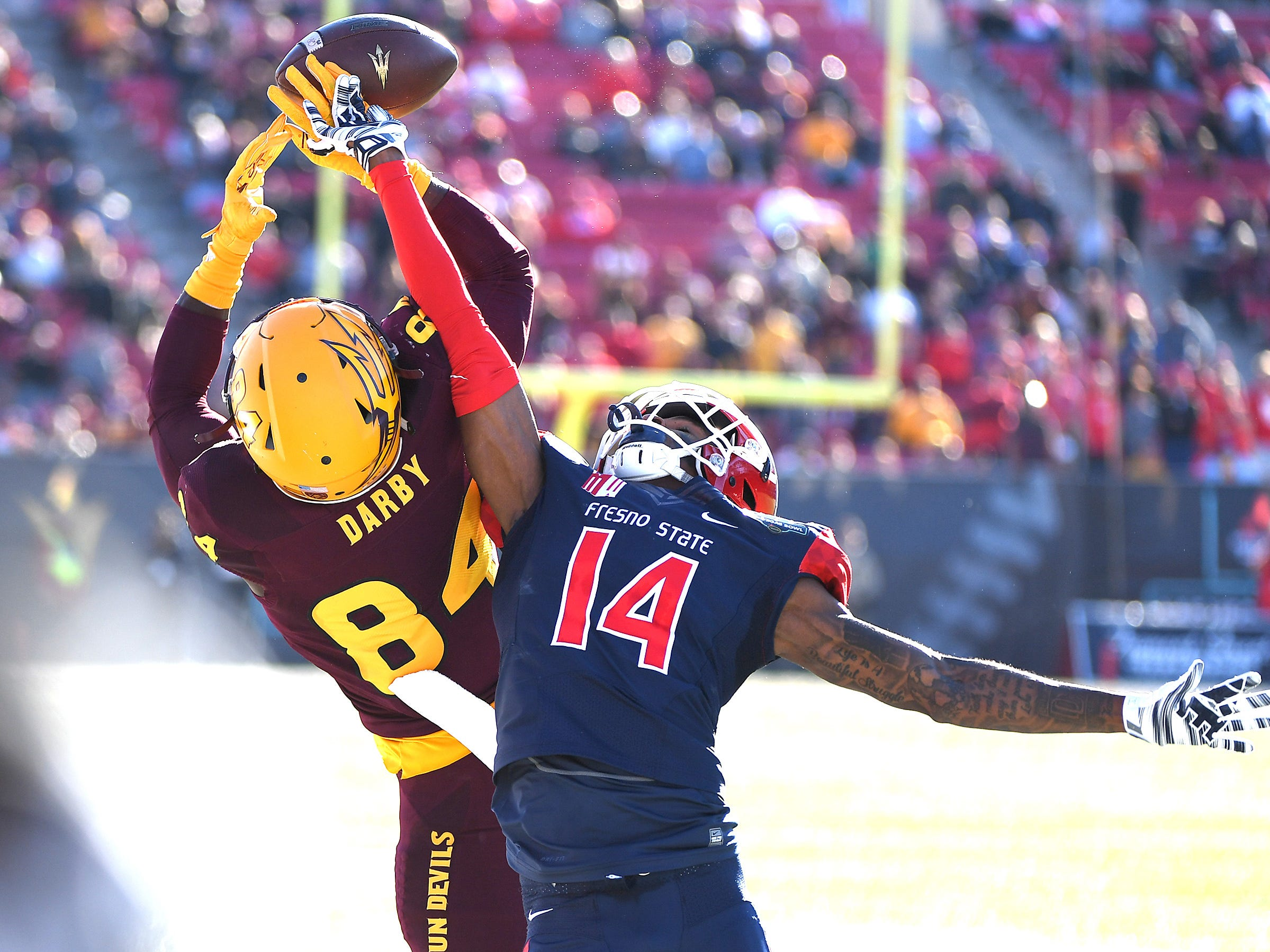 Dec 15, 2018; Las Vegas, NV, United States; Fresno State Bulldogs defensive back Jaron Bryant (14) breaks up a reception attempt by Arizona State Sun Devils wide receiver Frank Darby (84) during the first half at Sam Boyd Stadium.