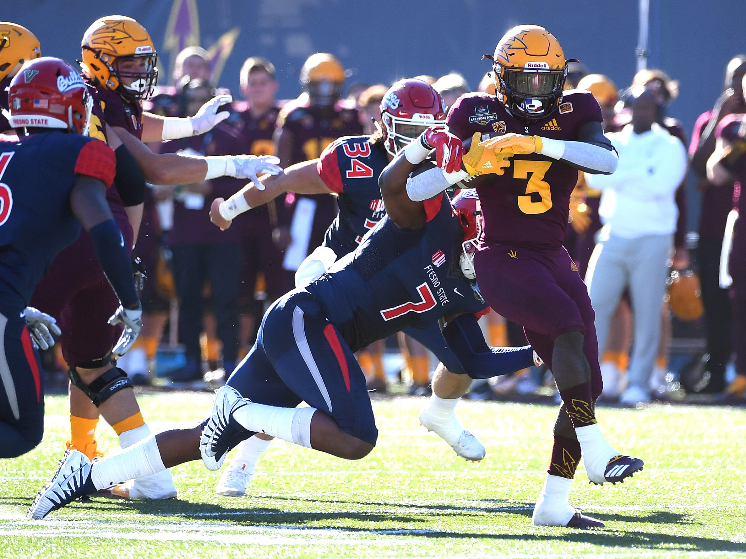 Dec 15, 2018; Las Vegas, NV, United States; Arizona State Sun Devils running back Eno Benjamin (3) breaks the tackle of Fresno State Bulldogs linebacker James Bailey (7) during the first half at Sam Boyd Stadium.