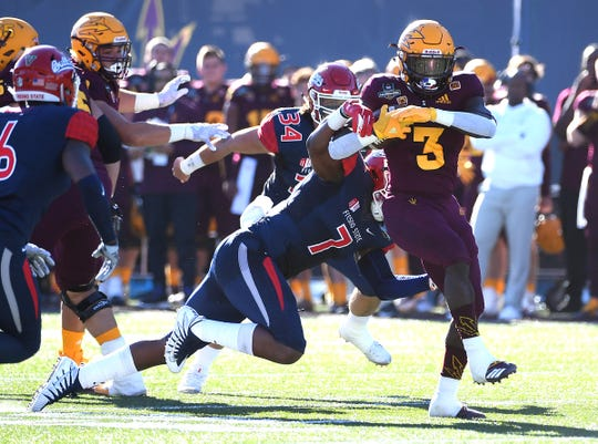 Arizona State Sun Devils running back Eno Benjamin (3) breaks the tackle of Fresno State Bulldogs linebacker James Bailey (7) during the first half at Sam Boyd Stadium.