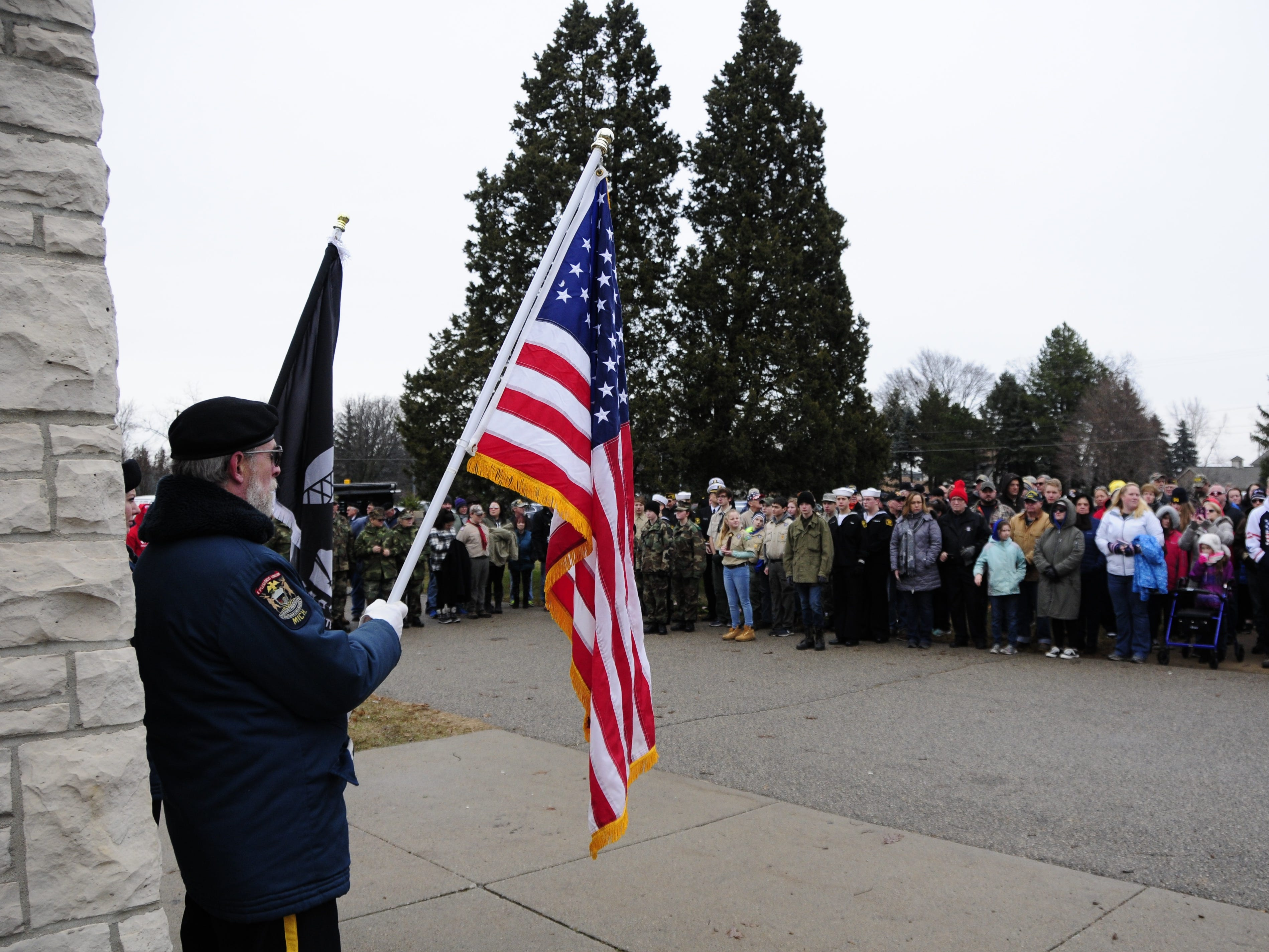 Al Hyde and Heather Sheldon hold an American flag and a POW/MIA flag during the Wreaths Across America event on Saturday, Dec. 15, 2018 at the St. Clair County Allied Veterans Cemetery.