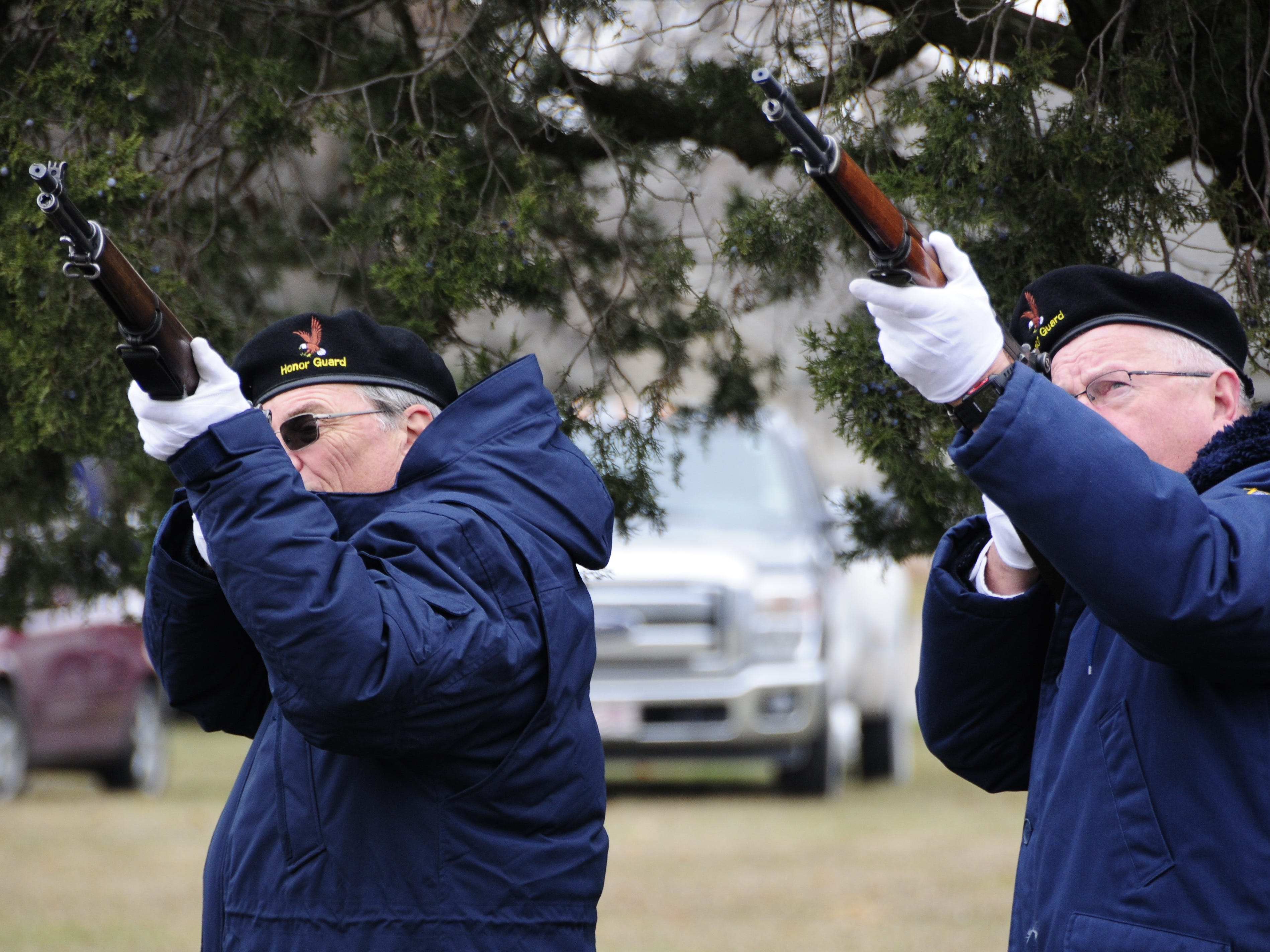 Steve Tebay, left, and Lee Pochert fire a salute during the Wreaths Across America event on Saturday, Dec. 15, 2018 at the St. Clair County Allied Veterans Cemetery.