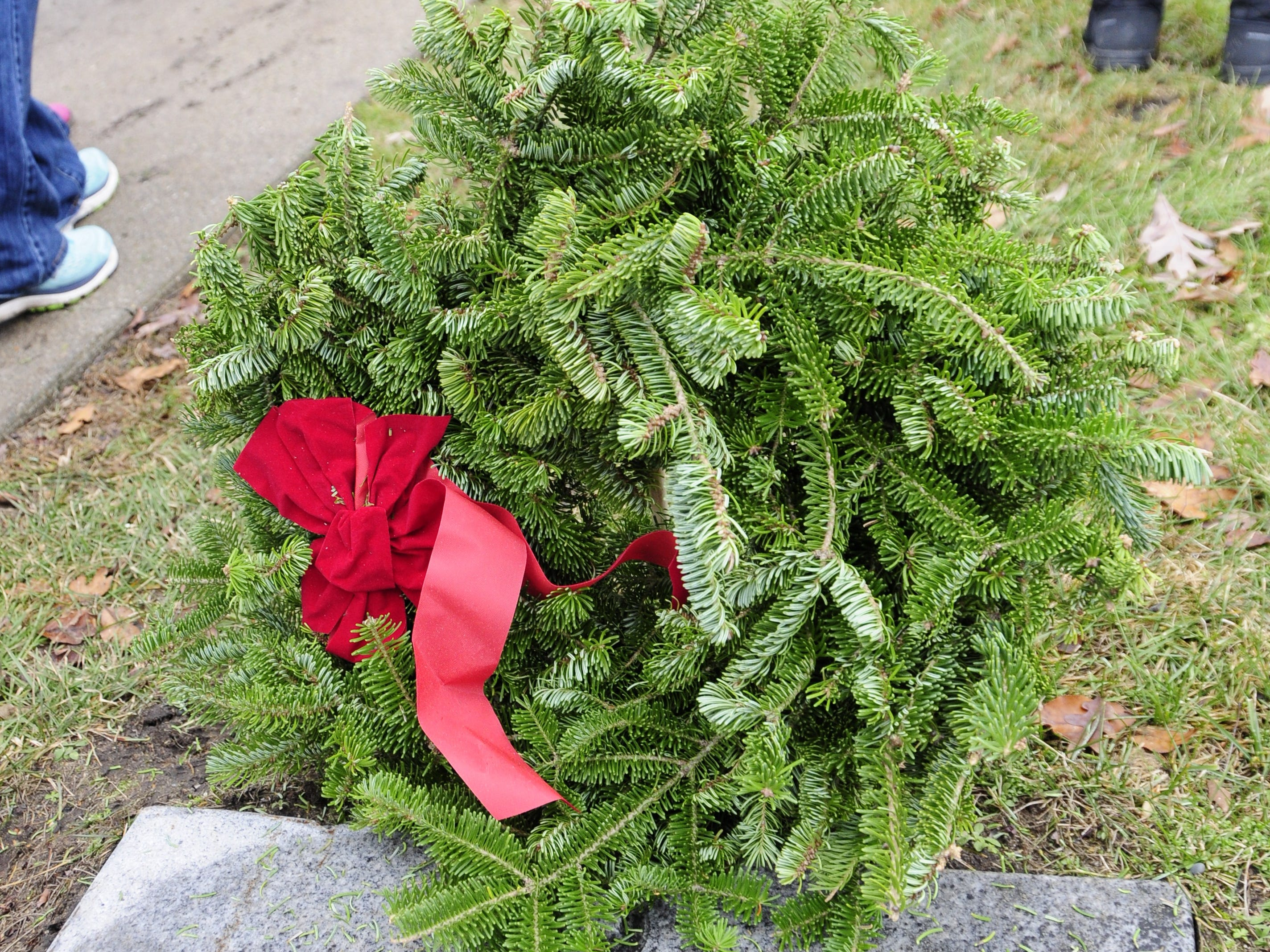 A wreaths marks a grave during Wreaths Across America on Saturday, Dec. 15, 2018 at St. Clair County Allied Veterans Cemetery in Port Huron.