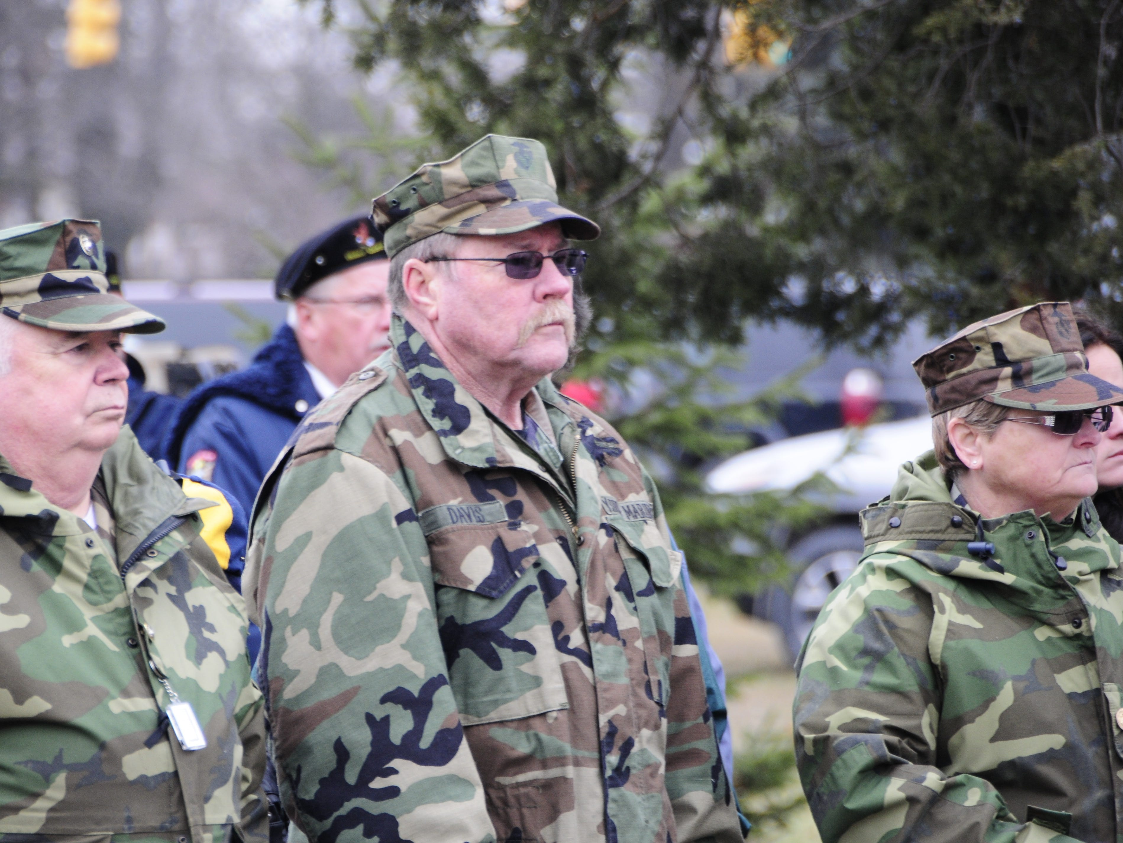 John Ritter, left, and Gary and Mary Davis listen to speakers during the Wreaths Across America event on Saturday, Dec. 15, 2018 at the St. Clair County Allied Veterans Cemetery.