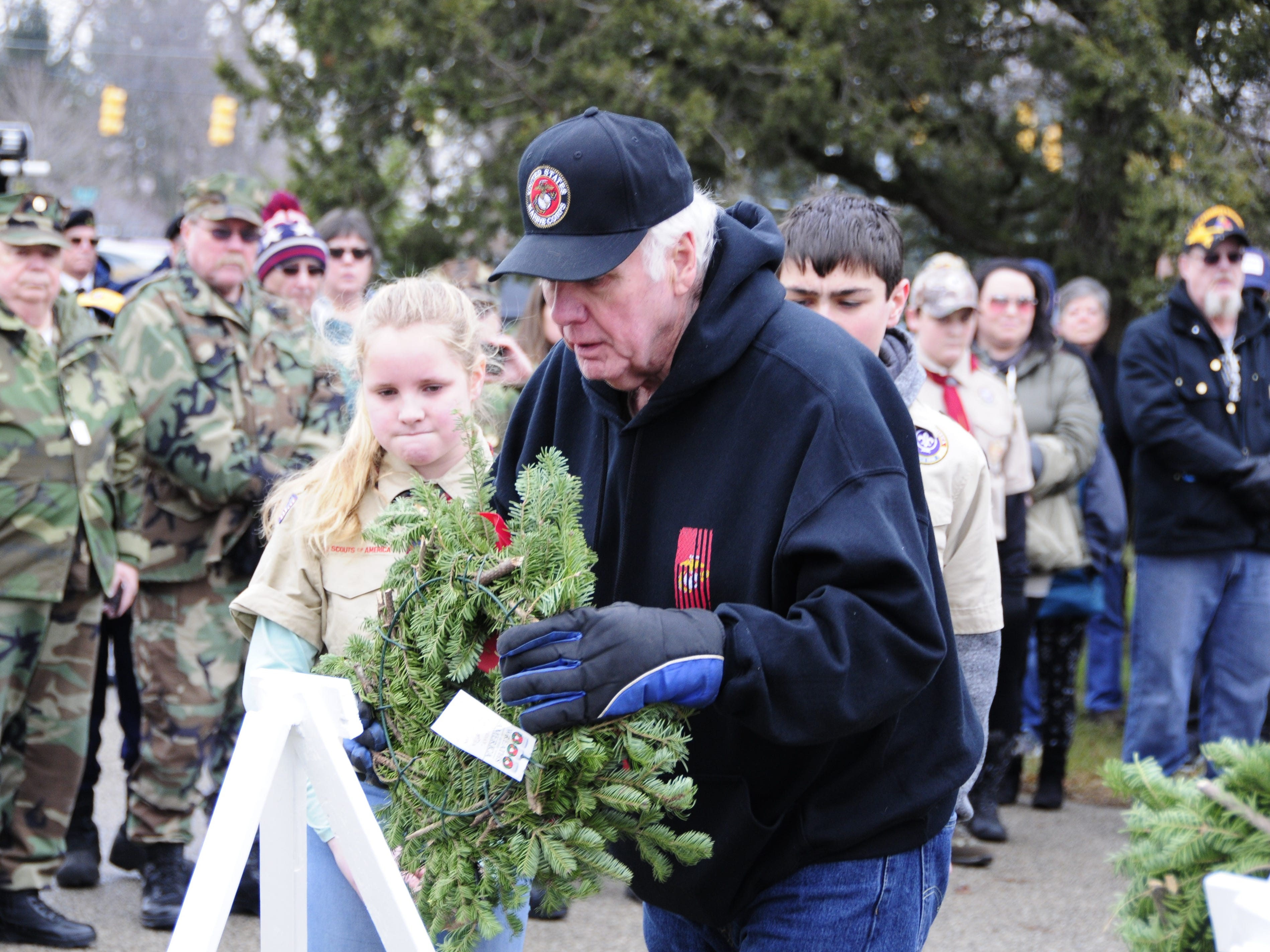 Bill Tucker places a wreath to honor the U.S. Marines during Wreaths Across America on Saturday, Dec. 15, 2018 at St. Clair County Allied Veterans Cemetery in Port Huron.