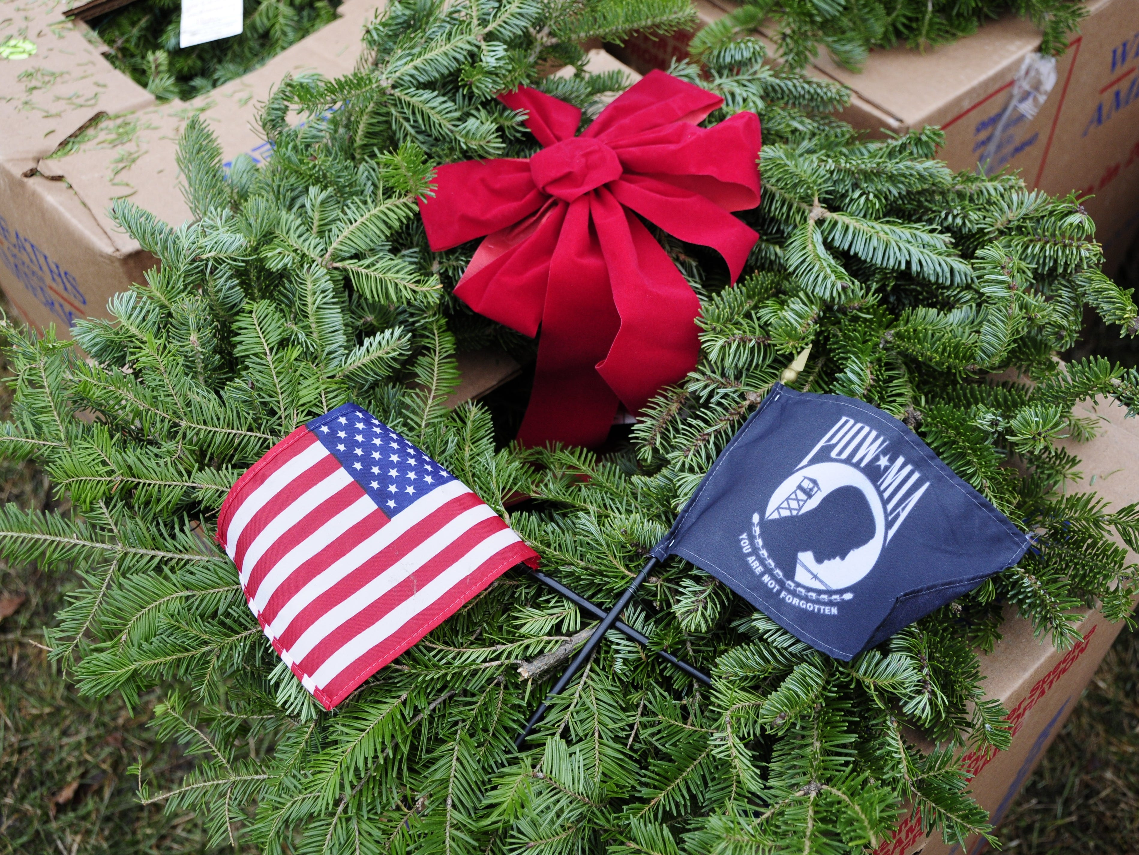 Volunteers placed 889 wreaths during the Wreaths Across America event on Saturday, Dec. 15, 2018 at the St. Clair County Allied Veterans Cemetery.