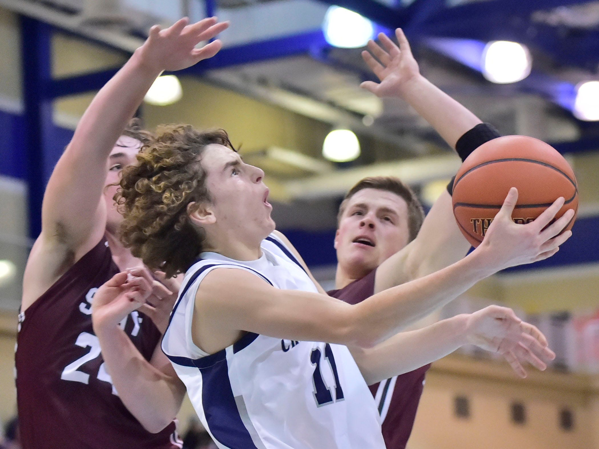Chambersburg's Aaron Maynard (11) shoots against State College defenders. Chambersburg dropped a buzzer-beater 42-40 to State College during  D3 basketball, Friday, Dec. 14, 2018.