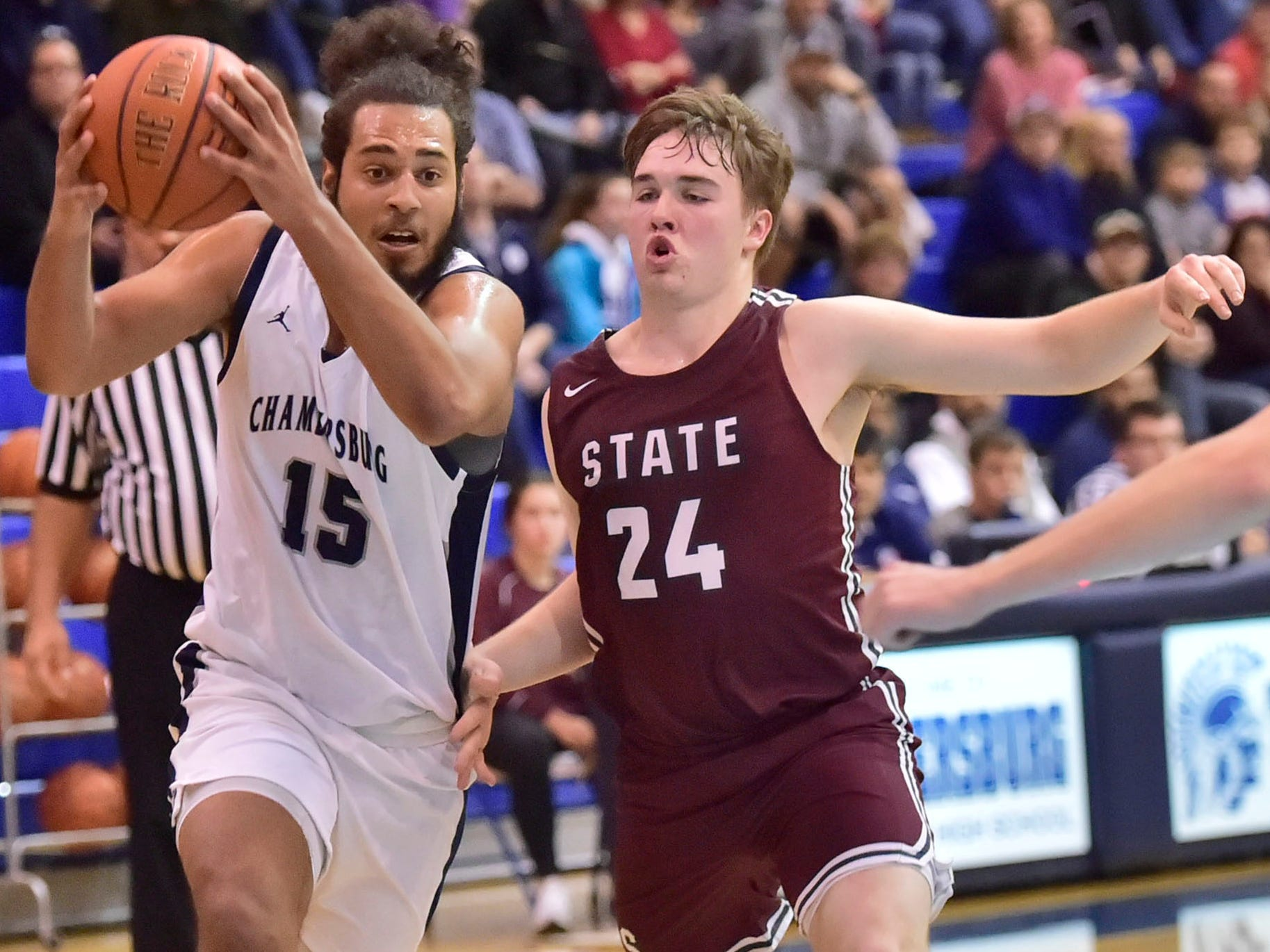 Chambersburg's Tyler Collier (15) drives to the basket against State College. Chambersburg dropped a buzzer beater 42-40 to State College during a District 3 basketball, Friday, Dec. 14, 2018.