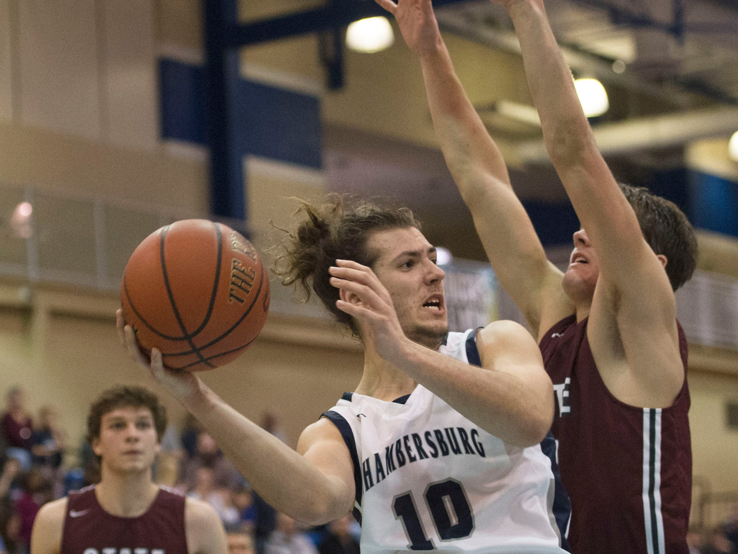 Seth Brouse of Chambersburg shoots. Chambersburg dropped a buzzer-beater 42-40 to State College during  D3 basketball, Friday, Dec. 14, 2018.