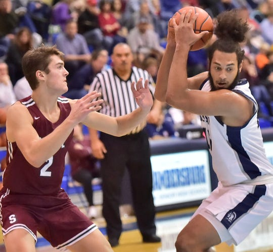 Chambersburg's Tyler Collier gets position to shoot against State College's Johnny Friberg. Chambersburg dropped a buzzer-beater 42-40 to State College during  D3 basketball, Friday, Dec. 14, 2018.
