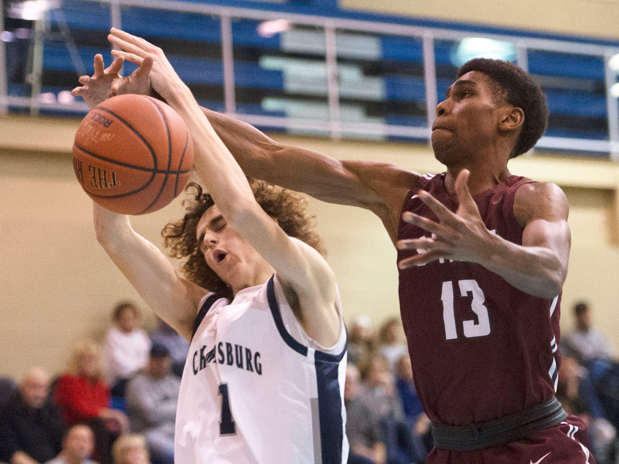 Chambersburg's Aaron Maynard, left, shoots against State College's Cam Villarouel. Chambersburg dropped a buzzer beater 42-40 to State College during a District 3 basketball, Friday, Dec. 14, 2018.