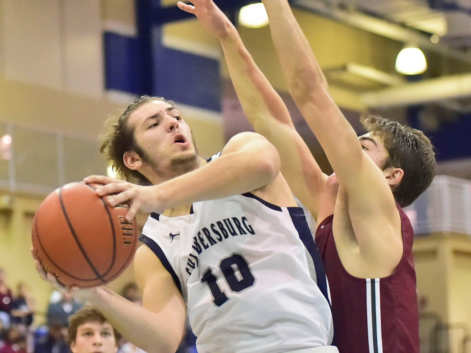 Chambersburg's Seth Brouse drives against a State College defender. Chambersburg dropped a buzzer beater 42-40 to State College during District 3 basketball game, Friday, Dec. 14, 2018.