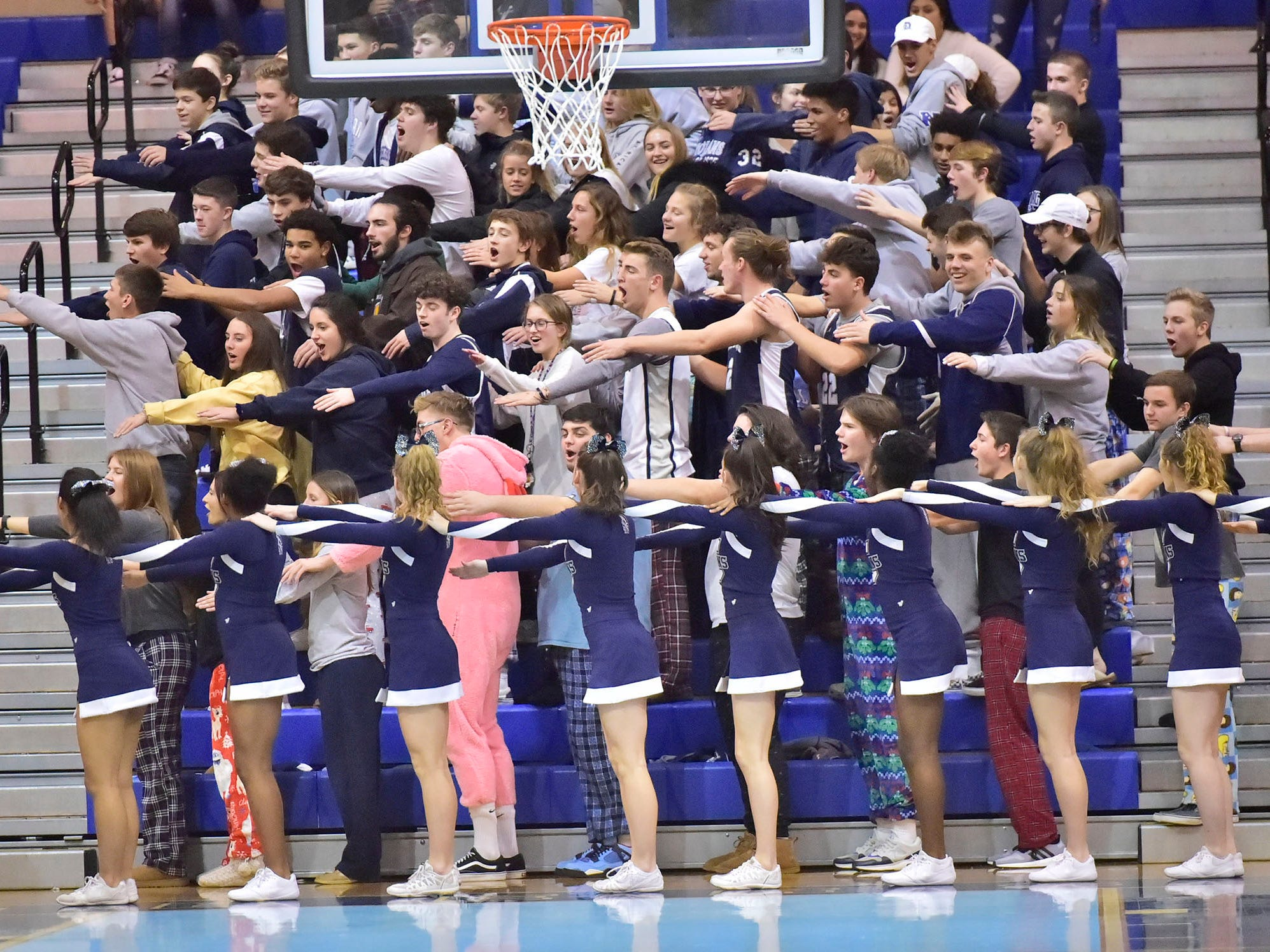 Chambersburg fans join cheerleaders. Chambersburg dropped a buzzer-beater 42-40 to State College during  D3 basketball, Friday, Dec. 14, 2018.