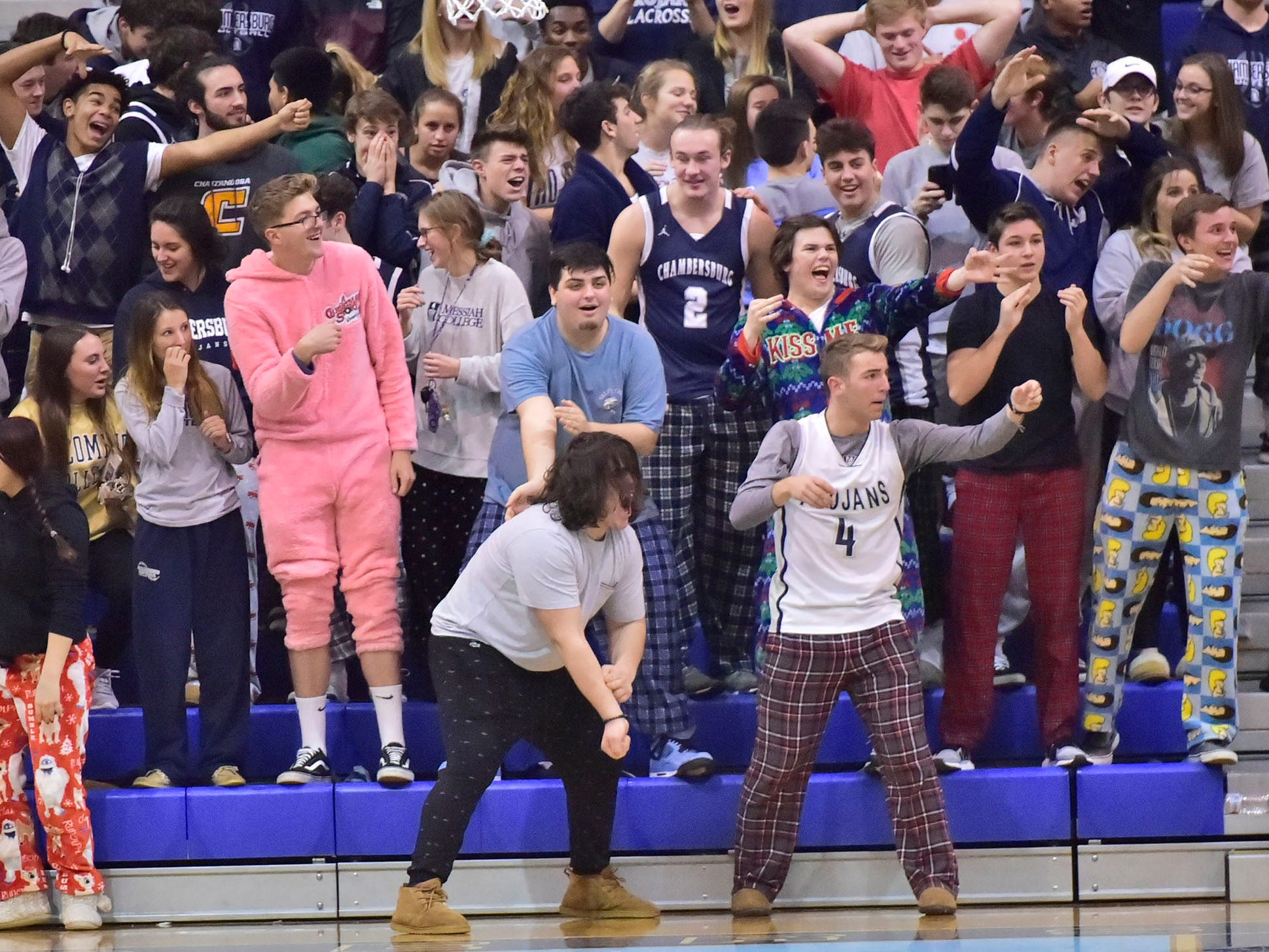 Trojan fans celebrate a tie score. Chambersburg dropped a buzzer-beater 42-40 to State College in PIAA D3 action, Friday, Dec. 14, 2018.