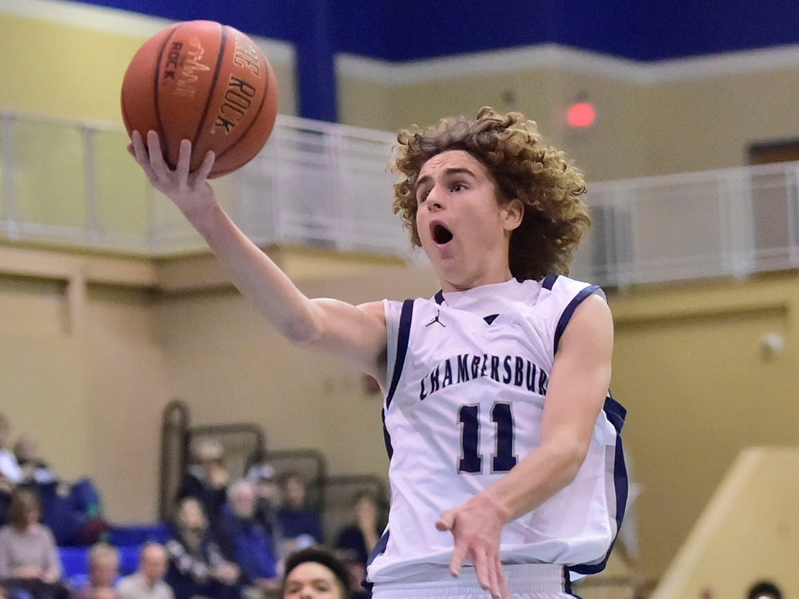 Aaron Maynard of Chambersburg drives to the basket. Chambersburg dropped a buzzer-beater 42-40 to State College during  D3 basketball, Friday, Dec. 14, 2018.
