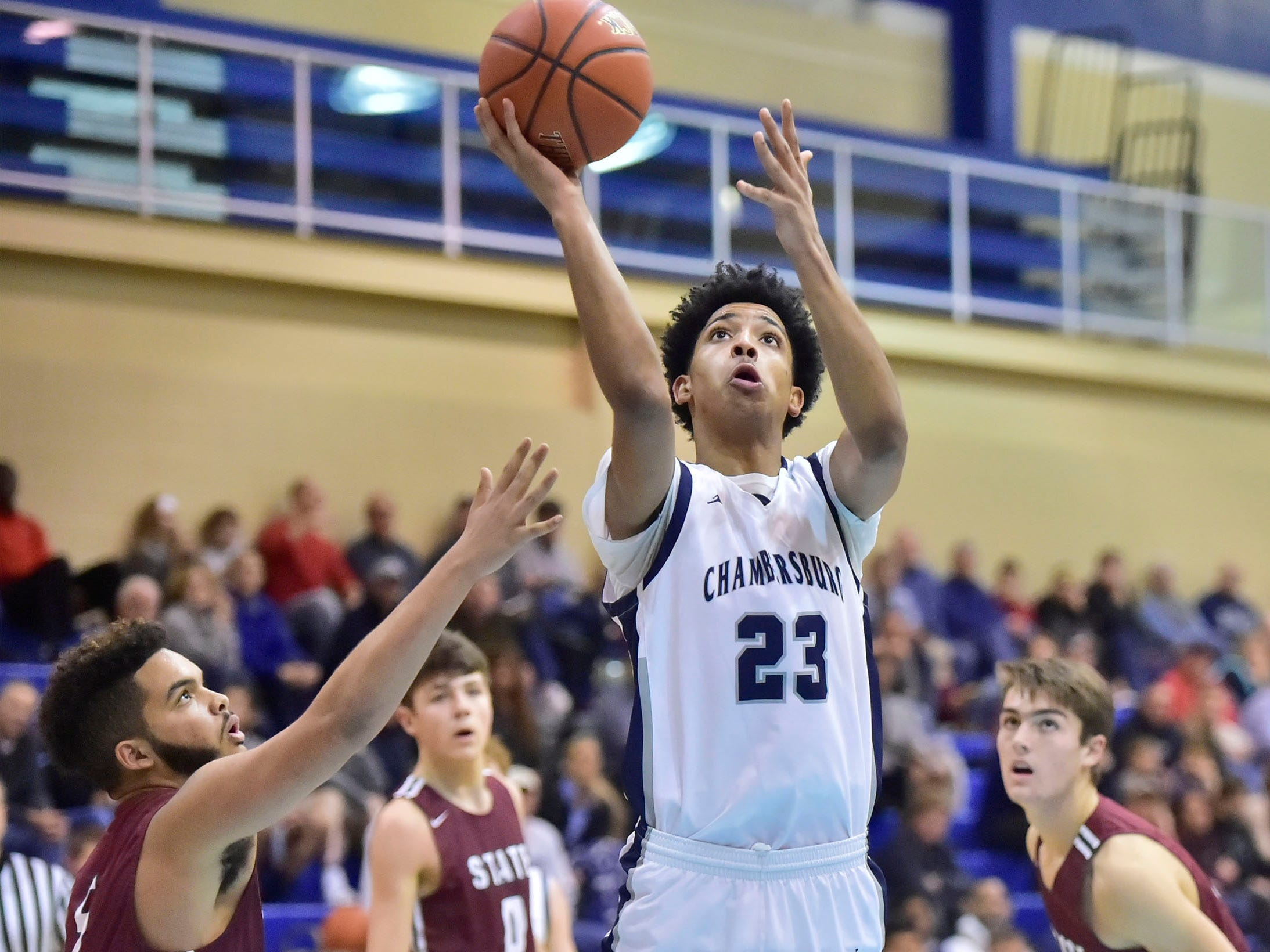 Max Doctor (23) shoots for the Trojans. Chambersburg dropped a buzzer-beater 42-40 to State College during  D3 basketball, Friday, Dec. 14, 2018.