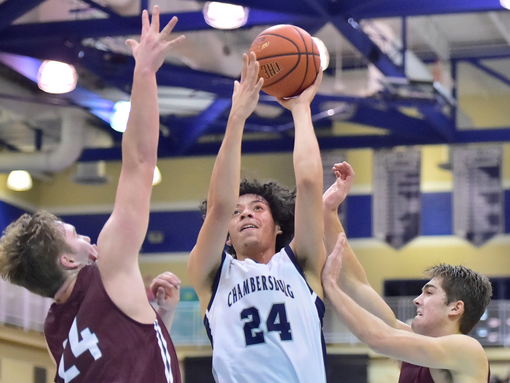 Chambersburg's Ty Holsopple (24) drives to the basket. Chambersburg dropped a buzzer-beater 42-40 to State College during  D3 basketball, Friday, Dec. 14, 2018.