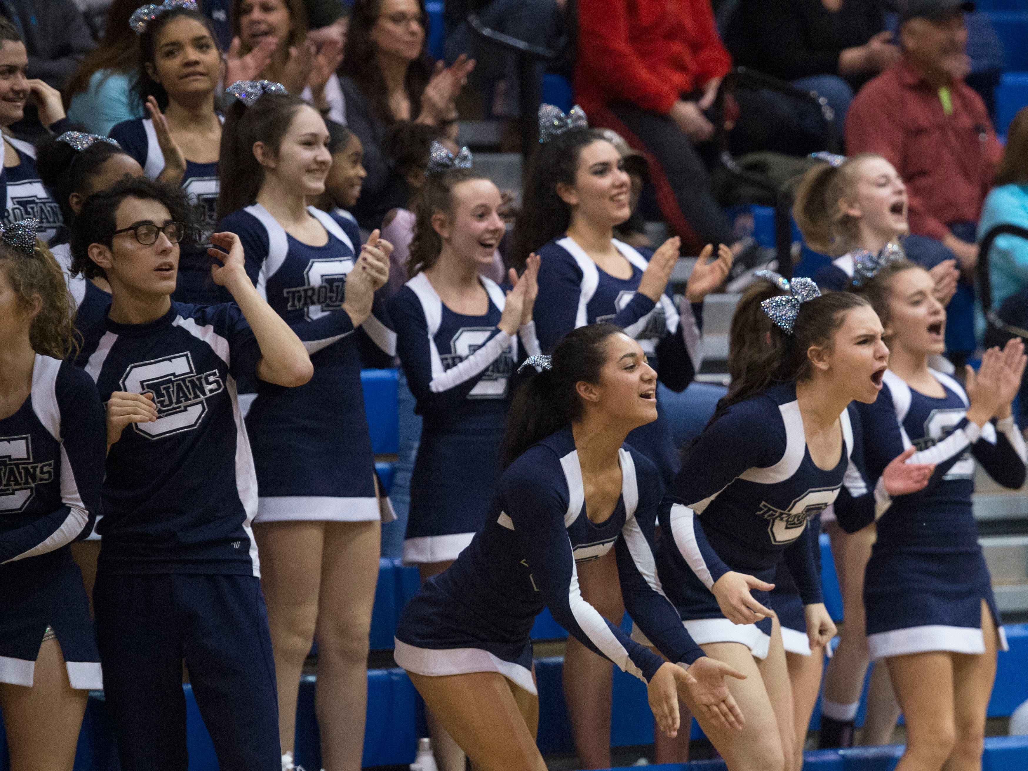 Chambersburg cheerleaders cheer on the team after a Tyler Collier shot ties the game. Chambersburg dropped a buzzer beater 42-40 to State College during a District 3 basketball, Friday, Dec. 14, 2018.